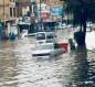 بالصور :امطار غزيرة تغرق شواع النجف ومحافظها يعلق